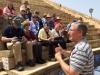 The group seated in the ampitheatre at Caesarea Maritima